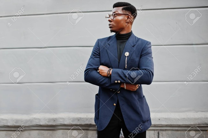 Amazingly Looking African American Man Wear At Blue Blazer With Brooch, Black  <a class=