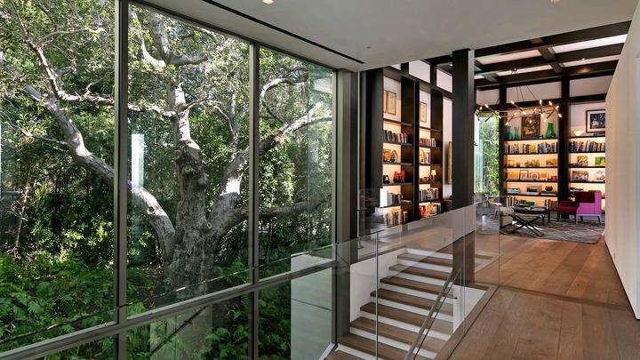 It has a wealth of floor-to-ceiling glass windows and doors.