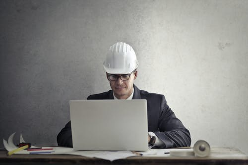 Engineer working with laptop at table