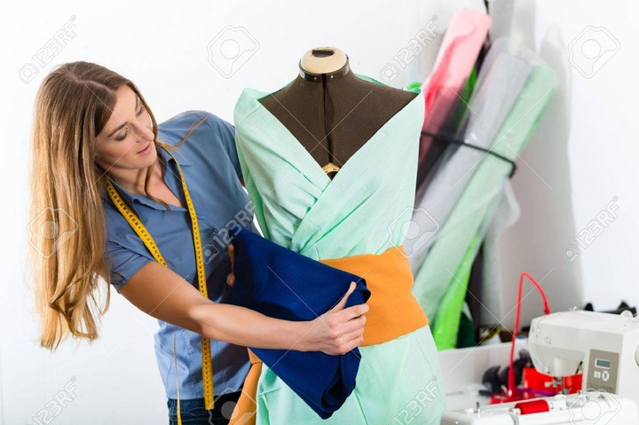 Freelancer - Fashion Designer Or Tailor Working On A Design Or Draft, She  Takes Measure On A Dressmakers Dummy Stock Photo, Picture And Royalty Free  Image. Image 19762005.