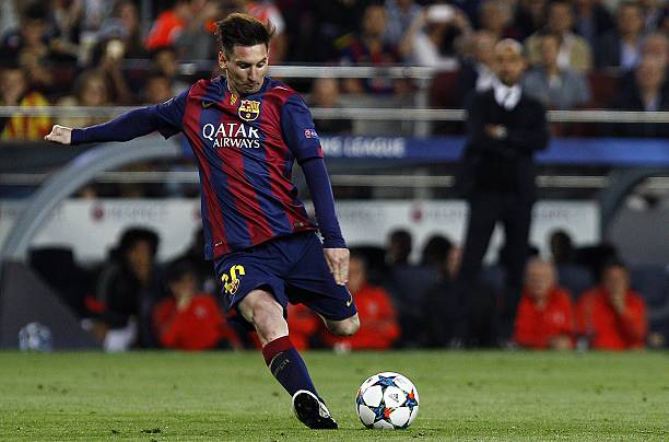 Barcelona's Argentinian forward Lionel Messi kicks the ball on a free-kick while Bayern Munich's Spanish head coach <a class=