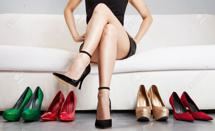 Beautiful Leg Of Woman Sitting On The Sofa With Many High Heels. Stock  Photo, Picture And Royalty Free Image. Image 52715635.