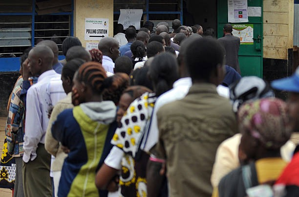 Kenyan voters wait to cast their ballots, on August 4, 2010 at a Primary School within the Mathare slum, in Nairobi, in the ongoing constitutional...