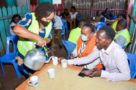 Kirinyaga Governor Anne Waiguru serving tea to Mwea residents at Freshna Cafe on Monday, September 27.