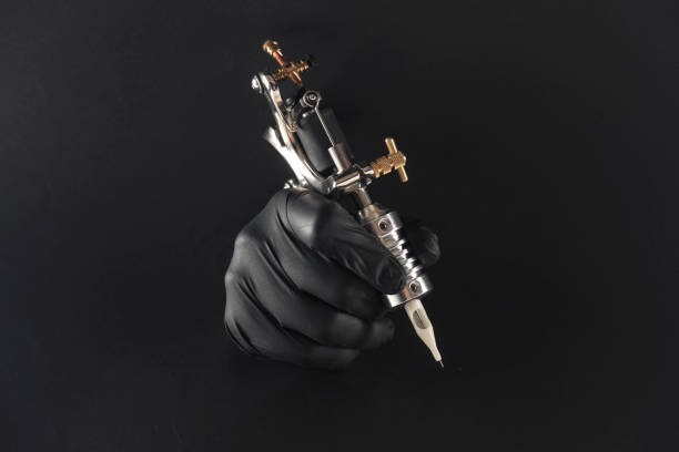 tattoo machine - black hand tattoo stock pictures, royalty-free photos & images