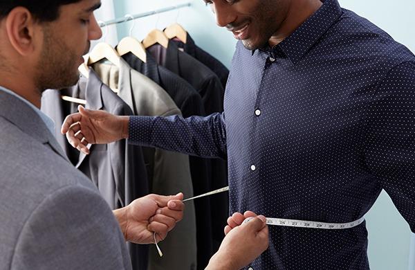 man-getting-measured-for-tailoring-1_jpg-600x390 - ACG Kenya