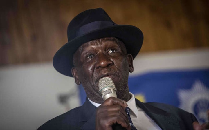 Bheki Cele wearing a hat: Police Minister <a class=