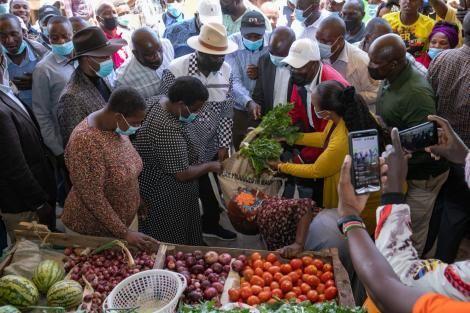 ODM leader Raila Odinga purchasing vegetables from a vendor on Monday, September 27.