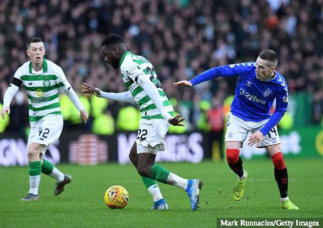 Odsonne Edouard of Celtic takes on Ryan Kent of Rangers during the Ladbrokes Premiership match between Celtic and Rangers at Celtic Park on December 29, 2019 in Glasgow, Scotland.