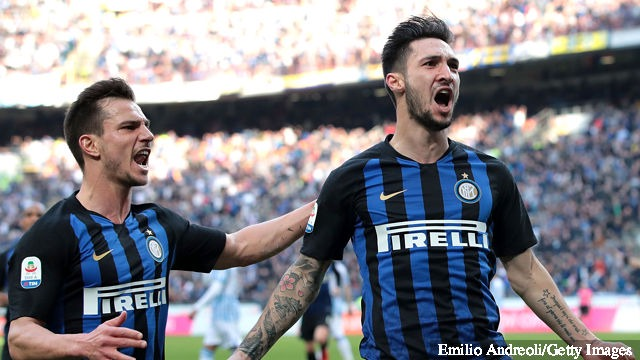 Matteo Politano (R) of FC Internazionale celebrates with his team-mate Cedric Soares after scoring the opening goal during the Serie A match between FC Internazionale and SPAL at Stadio...