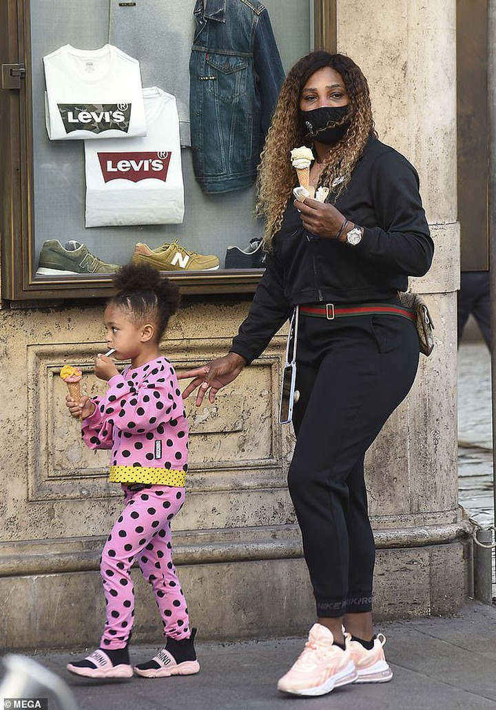 Cute:Serena looked casually cool in a black hoodie and matching joggers, paired with pastel pink trainers and a Gucci bag as she walked