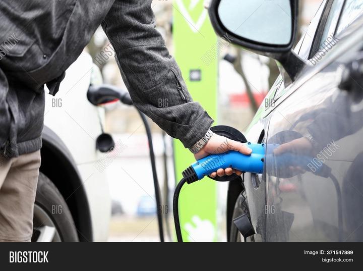 Man Fills Equipment Image & Photo (Free Trial) | Bigstock