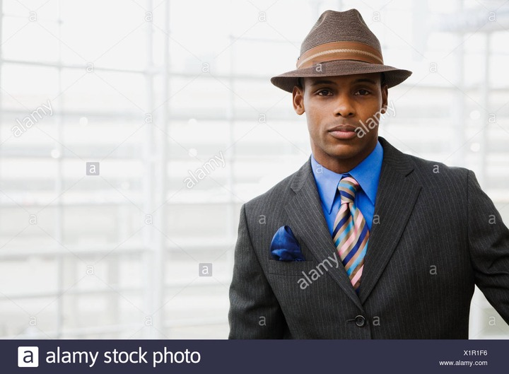 African man wearing suit and hat Stock Photo - Alamy