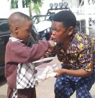 Photos: Meet the 38 years Old Nigerian actor Pawpaw and his son. 67