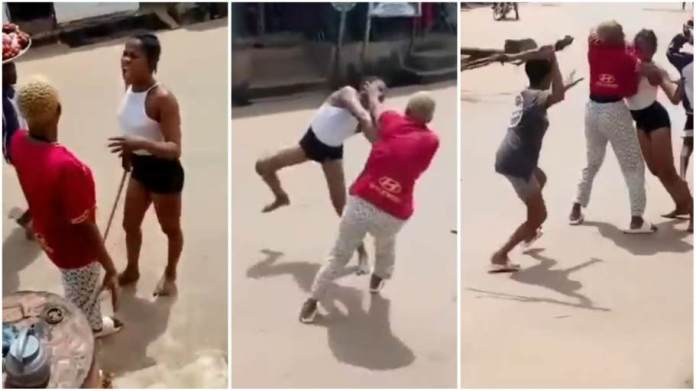 three girls fighting dirty on a busy street
