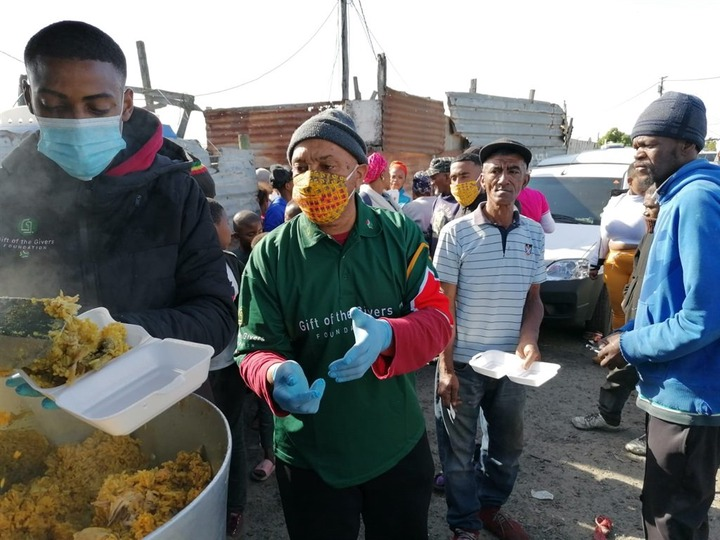 Gift of the Givers organisation handed out hot foods to the community of <a class=
