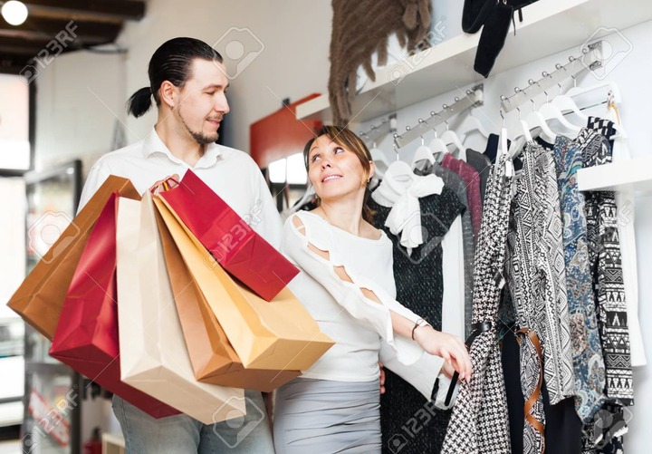 Ordinary Adult Couple Choosing Clothes At Clothing Shop Stock Photo,  Picture And Royalty Free Image. Image 33512454.