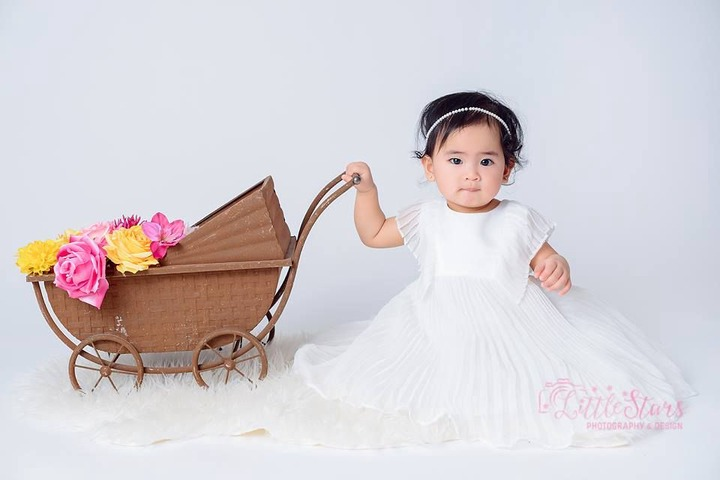 Baby Posing For a Photo   Baby girl white dress, Baby girl photography,  Baby girl photos