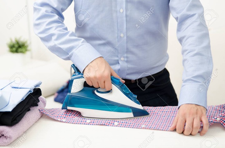 Man Ironing Shirt On Ironing Board. Steaming Blue Iron. Clothes Ironing  Board Household Concept Stock Photo, Picture And Royalty Free Image. Image  89582118.