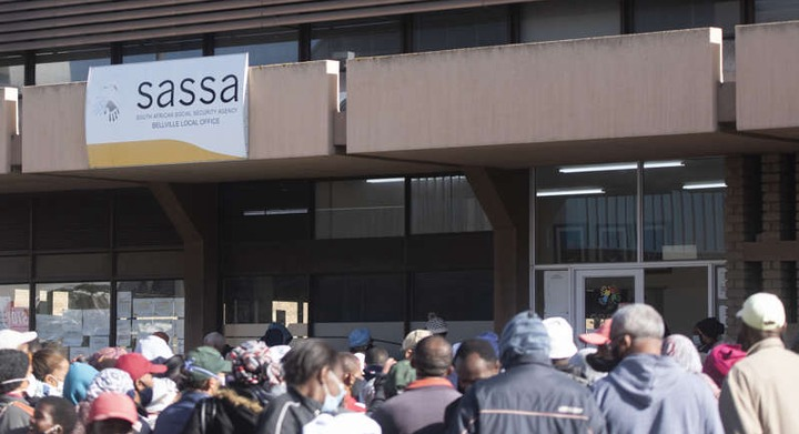 BELLVILLE, SOUTH AFRICA - APRIL 30: More the 500 people mostly elderly and disabled wait in lines outside <a class=