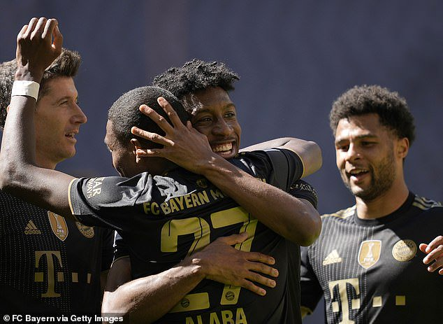 Augsburg'sJeffrey Gouweleeuw (centre) scored an own goal to put Bayern ahead on Saturday