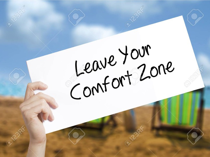 Leave Your Comfort Zone Sign On White Paper. Man Hand Holding Paper With  Text. Isolated On Holiday Background. Business Concept. Stock Photo Stock  Photo, Picture And Royalty Free Image. Image 75890895.