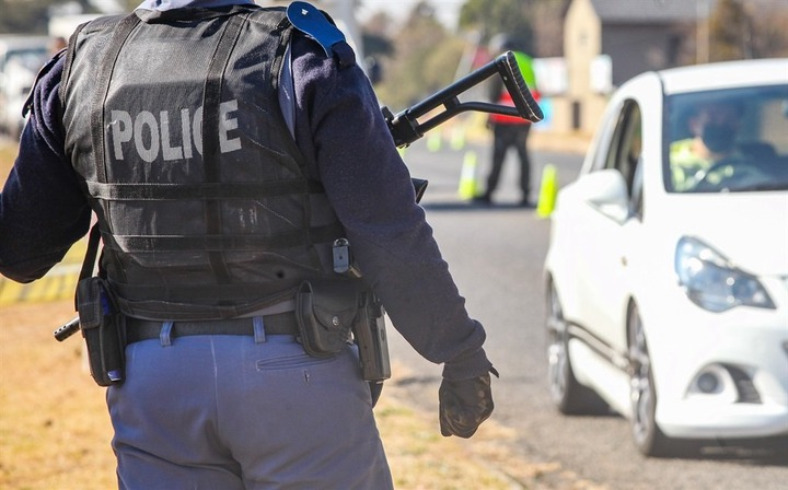Two police officers have been arrested in connection with armed robbery, attempted murder and kidnapping cases. (Photo by Gallo Images/Sharon Seretlo)