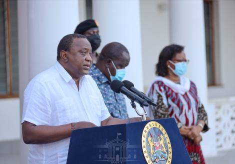 President Uhuru Kenyatta reading the review of containment measures of the virus on August 18, 2021.