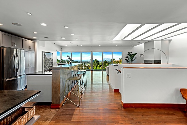 Walls of glass and skylights brighten living spaces that open to multiple decks hanging off the back of the home.