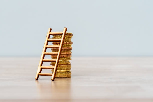 ladder on stack of coins - cash objective. stock pictures, royalty-free photos & images