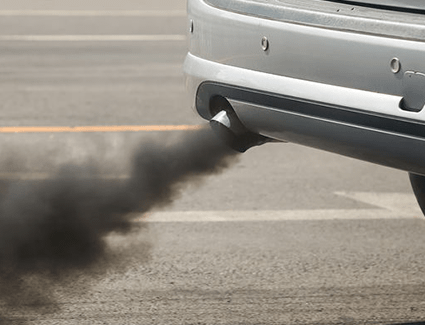 Black smoke from a tailpipe.