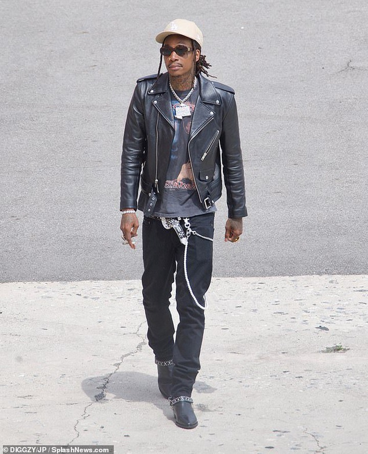 Fresh: Wiz stepped out wearing a heavy black leather jacket with silver studs and black skinny jeans featuring a long wallet chain
