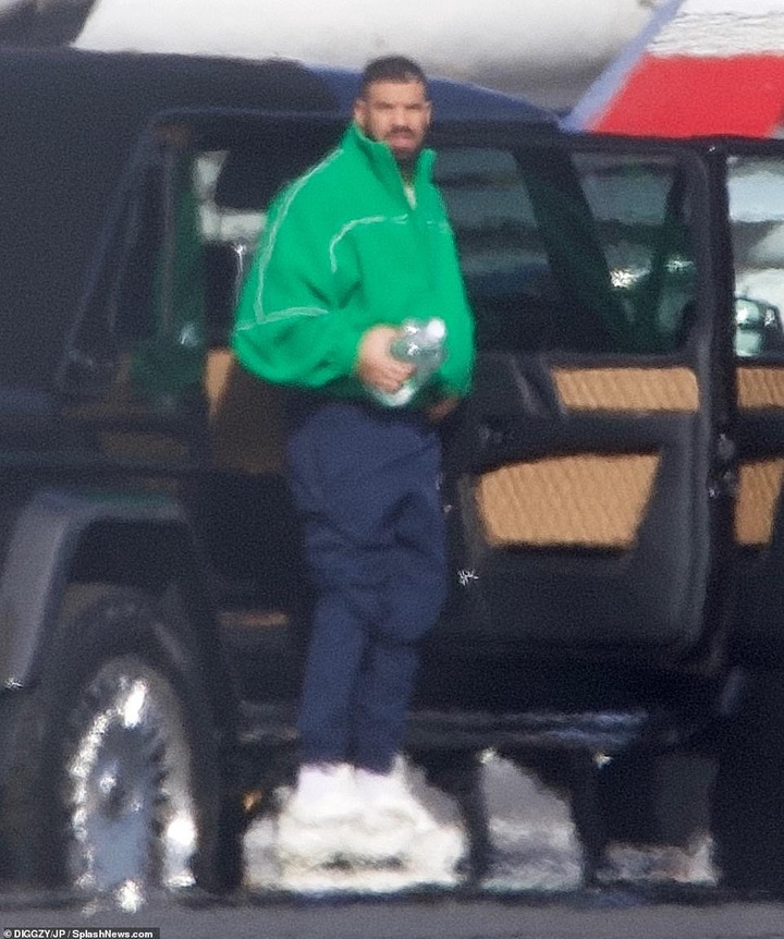Flash:Drake opted to travel in luxury on Tuesday as he climbed out of his $1.8 million Mercedes Maybach G650 Landaulet truck before boarding his private Boeing 767 Jet as he jetted out of LA