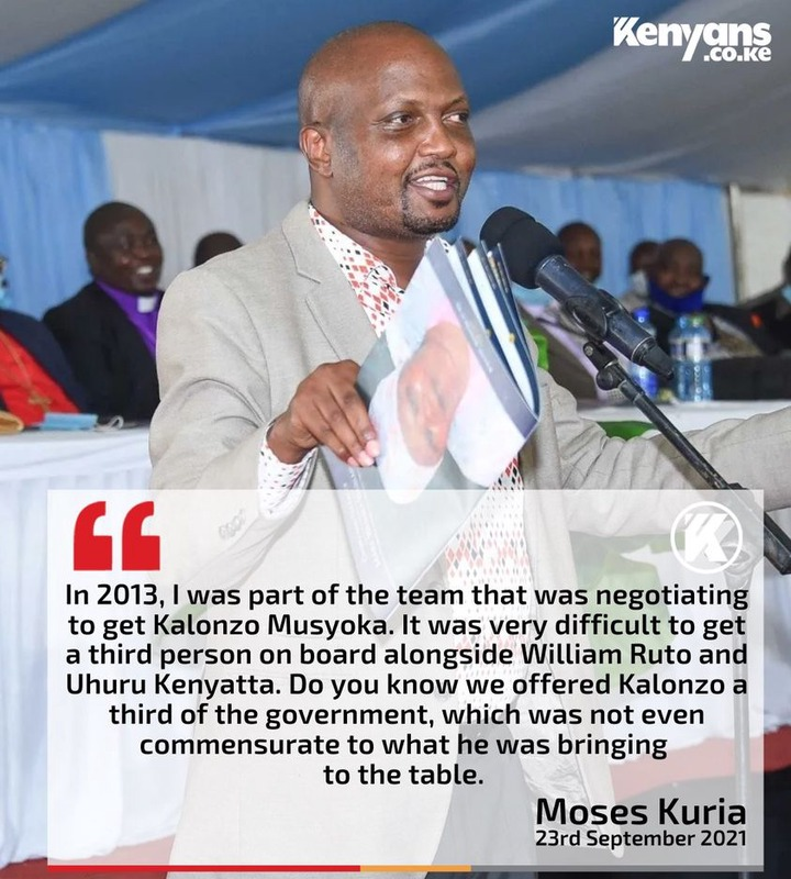 """May be an image of 3 people and text that says 'Kenyans .co.ke """" In 2013, I was part of the team that was negotiating to get Kalonzo Musyoka. It was very difficult to get a third person on board alongside William Ruto and Uhuru Kenyatta. Do you know we offered Kalonzo a third of the government which was not even commensurate to what he was bringing to the table. Moses Kuria 23rd September 2021'"""