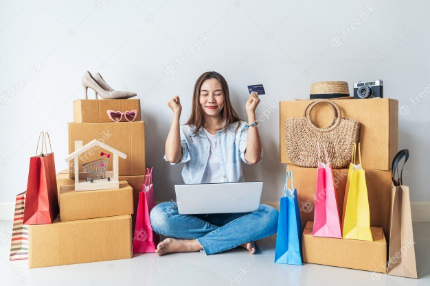 Premium Photo | Happy young asian woman with colorful shopping bag, fashion  items and stack of cardboard boxes at home