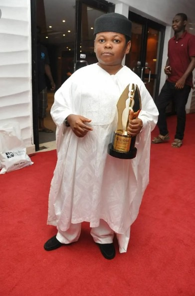 Photos: Meet the 38 years Old Nigerian actor Pawpaw and his son. 62