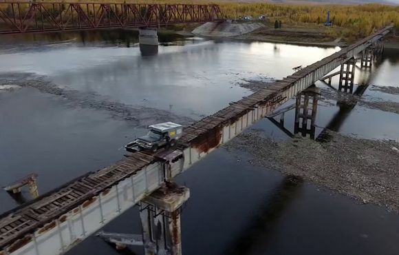 Watching an SUV cross this narrow, no-guardrail bridge is nerve-wracking    Driving