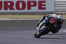 Marco Bezzecchi saat berlaga di MotoGP Misano. (Photo by ANDREAS SOLARO / AFP)