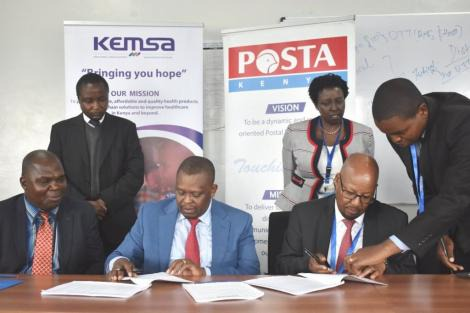 KEMSA CEO Jonah Manjari (left) with Postal Corporation of Kenya Postmaster General Dan Kagwe during the signing of a partnership for countrywide delivery of health products and technologies on January 14, 2020.