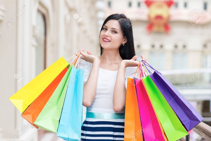 A Happy Smiling Lady With A Lot Of Colourful Shopping Bags From The Fancy  Shops. Luxury Shopping Venue. Stock Photo, Picture And Royalty Free Image.  Image 40765073.