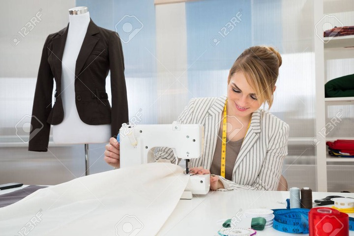 Smiling Fashion Designer Stitching Fabric On Sewing Machine Stock Photo,  Picture And Royalty Free Image. Image 39942640.